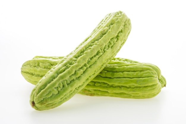 Green vegetables on white background