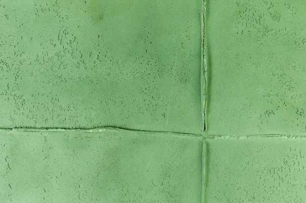 粗い質感の緑の壁ジョイント