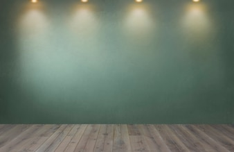 Green wall with a row of spotlights in an empty room