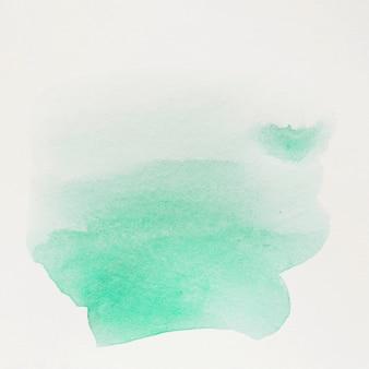 白い背景の上の緑色の水カラーブラシストローク