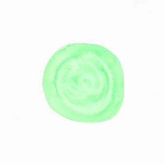 白の背景に分離された緑の水彩画のしみ
