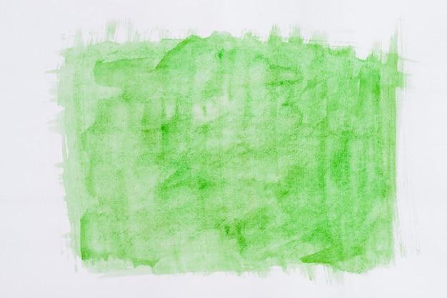 Green watercolor brushstroke on white background