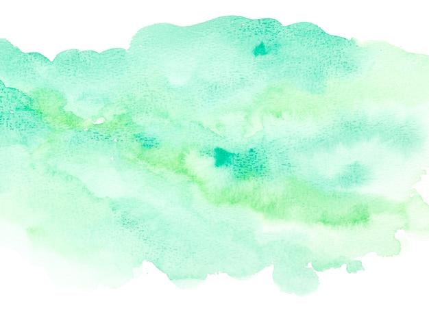 白い背景の上の緑の水彩画。抽象的なデザイン要素