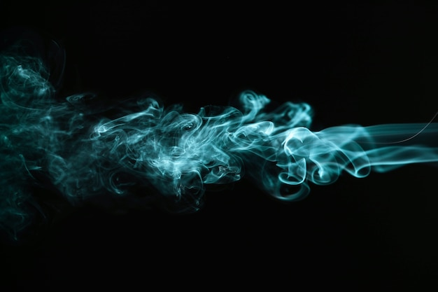 Green wavy smoke on black background