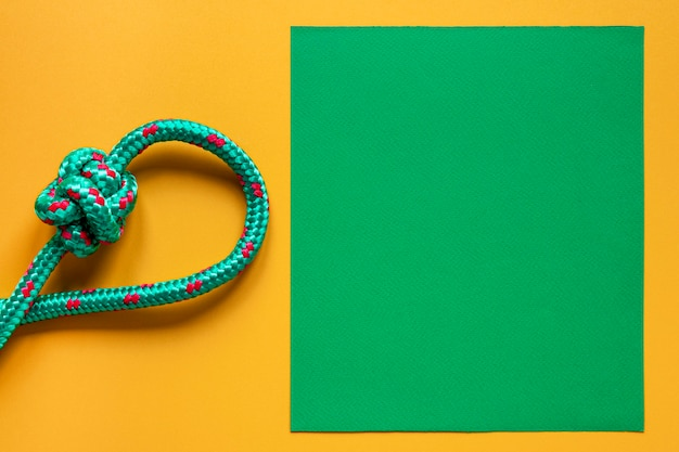 Green with violet dots sailor rope knot copy space