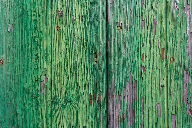 緑の木目テクスチャ。ヴィンテージのひびの入った塗料。