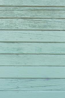スペースをコピーするための古いボードで作られた緑の木製の背景。ミントカラー