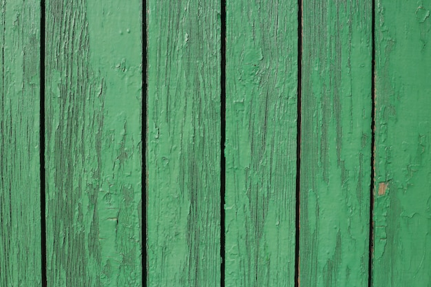 Green wooden texture. aged wooden material surface background.