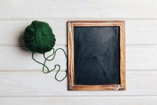 Green wool ball and slate