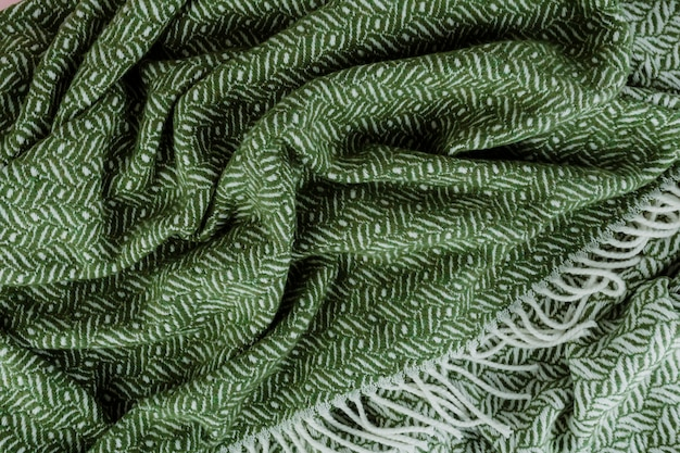 Green woven textured scarf background