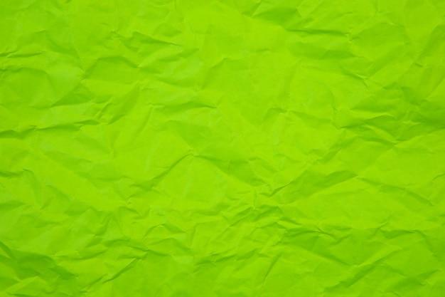 Зеленые морщинки скомканные старые с грубой текстурой страницы бумаги. складка гранж пергамент узор винтаж