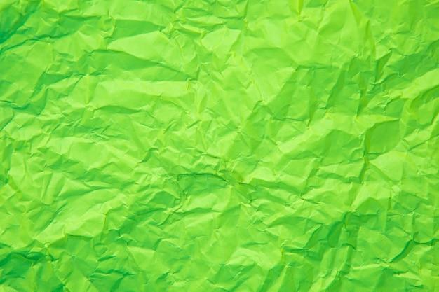 紙のページのテクスチャの粗い背景で古いしわくちゃの緑のしわ。しわグランジ羊皮紙パターンヴィンテージ