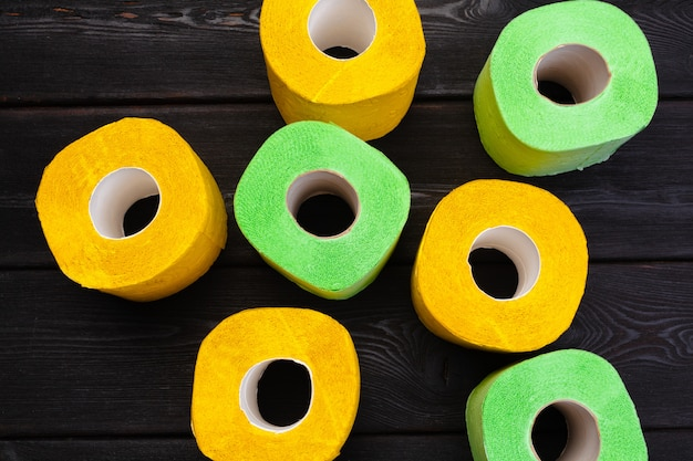 Green and yellow toilet paper rolls top view
