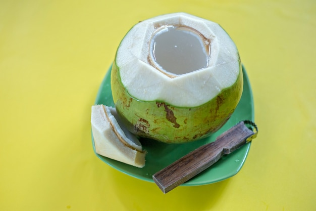Green young coconut with grater