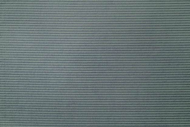 Greenish gray corduroy fabric textured background
