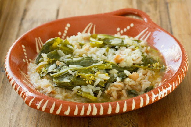 Greens with smoked portuguese sausage and rice