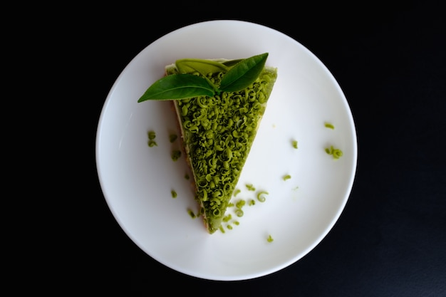 Greentea cake on dish with tea leaf
