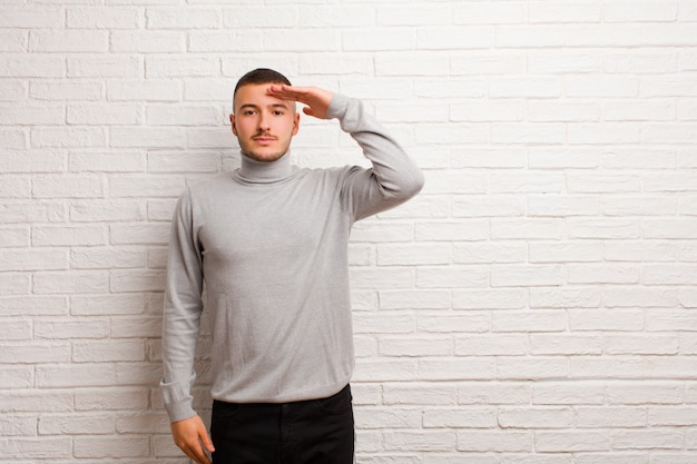 Greeting the camera with a military salute in an act of honor and patriotism, showing respect