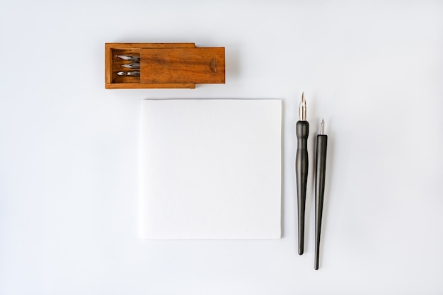 Greeting card mockup with fountain pen on white background. blank card template for world press freedom day.