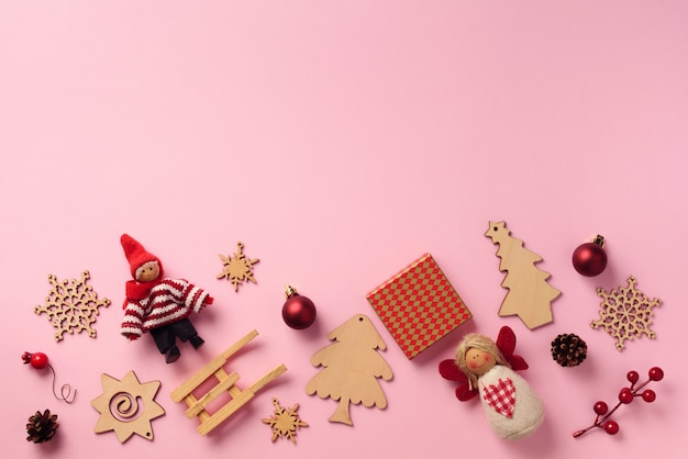 Greeting card for new year party. christmas gifts, decorative elements and ornaments on pink background.