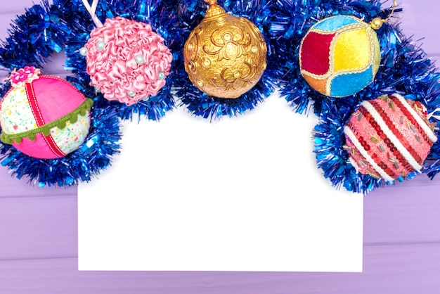 Greeting card sheet of paper mock up with christmas ornaments and balls