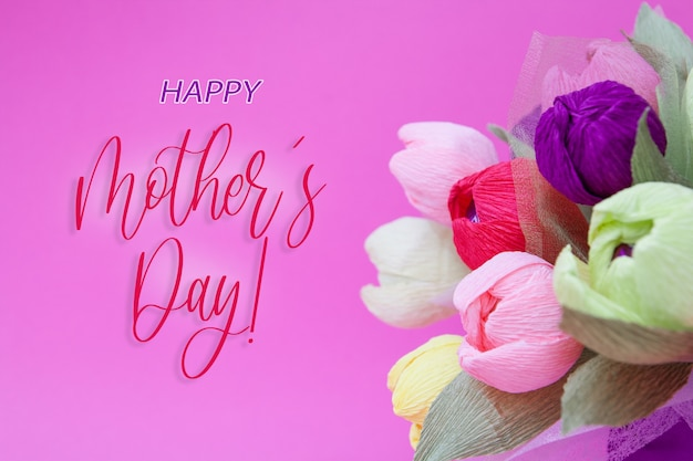 Greeting card with colorful bouquet of paper tulips and the inscription happy mothers day