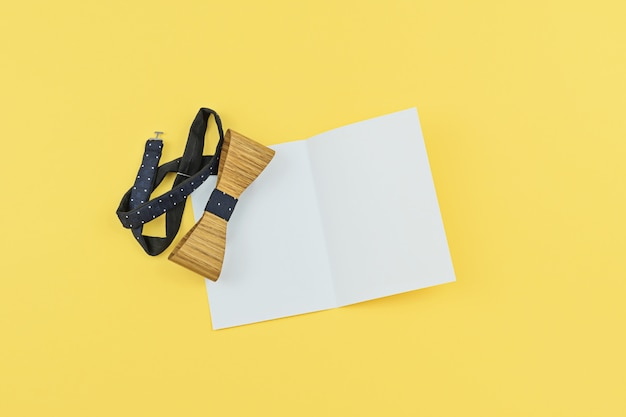 Greeting card with copy space and wooden tied bo