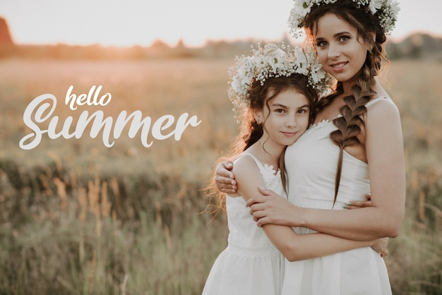 Greeting card with the inscription hello summer. happy mother and daughter with flower wreaths