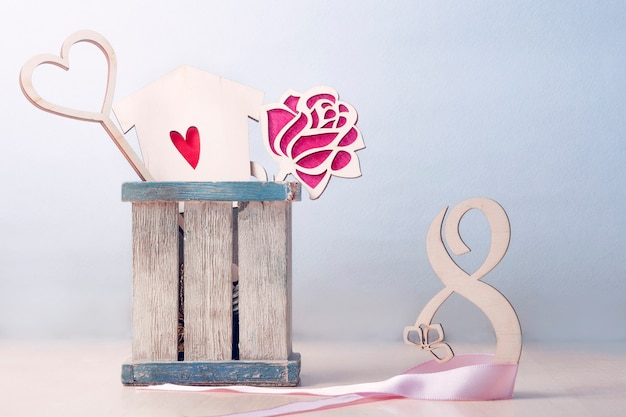 Greeting card for women's day. on the right is the number 8 entwined with a pink ribbon. left box with a bouquet of two hearts and roses.