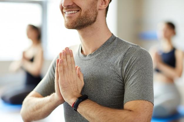 Greeting yoga teacher at class