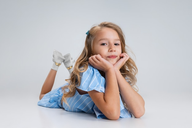 Gremaces, having fun. caucasian little girl isolated on white