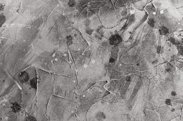 しっくいの汚れや水しぶきと灰色の抽象的な背景テクスチャ。黒と白