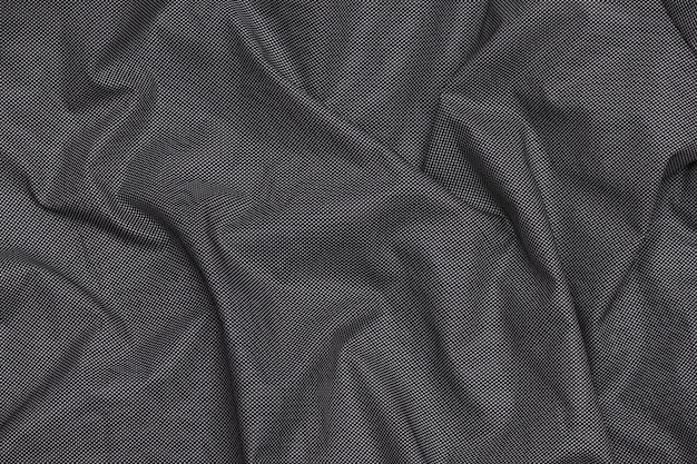 灰色の抽象的な暗いホログラフィック生地のテクスチャ背景