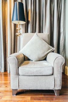 Grey armchair next to a lamp