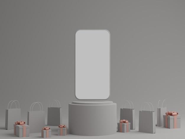 Серый фон с пустым белым экраном мобильного макета, подарочной коробкой и сумкой для покупок