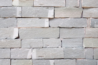 Grey brick and rough sandstone wall background