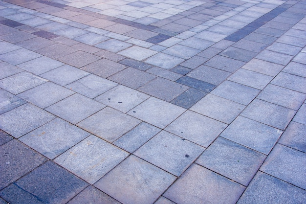 Grey brick pavement in the city in diagonal