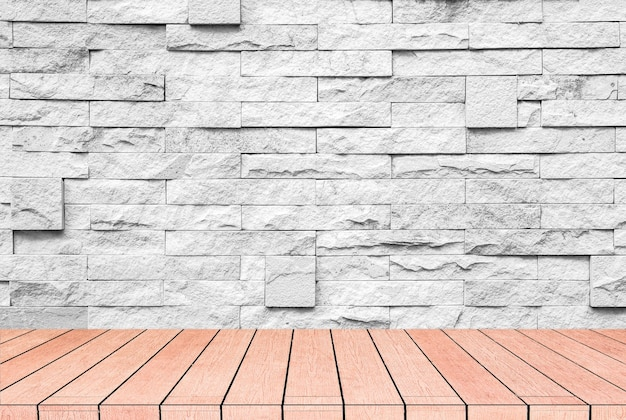 Grey brick and stone wall with warm brown wooden floor.