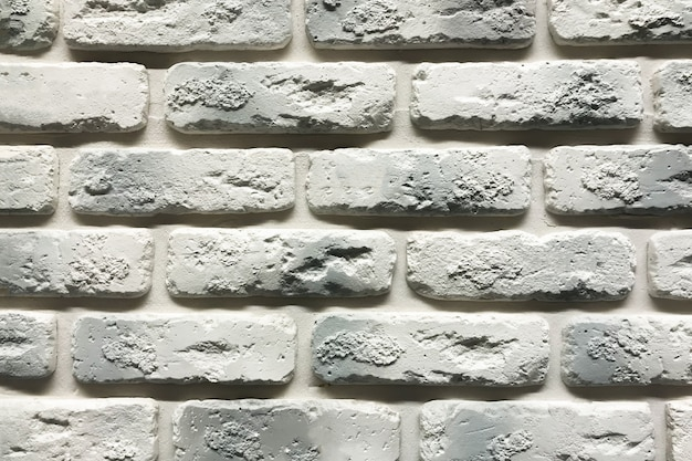 Grey brick wall texture background. tiled with cope space