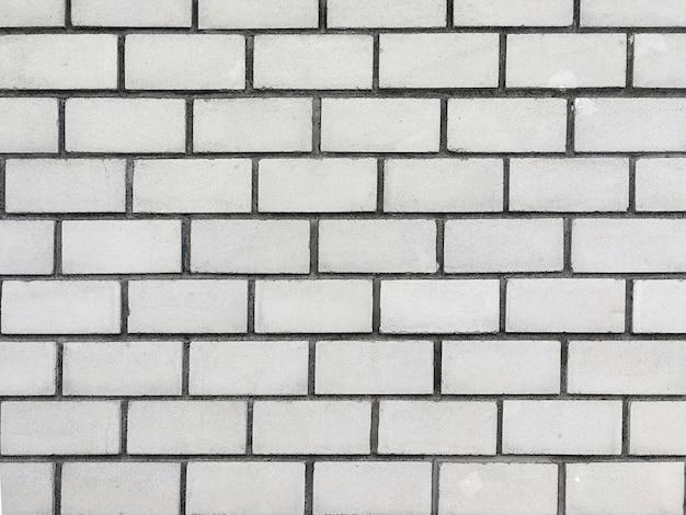 Grey brick wall texture background.