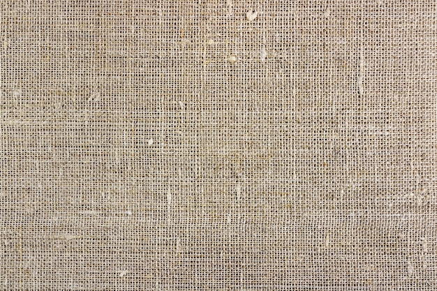 灰色の黄麻布の質感。天然素材の背景