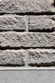 Grey cement brick wall outdoors background