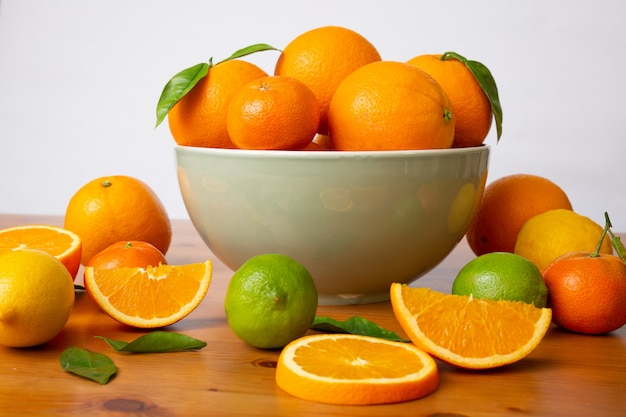 Grey ceramic bowl with fresh citrus fruits