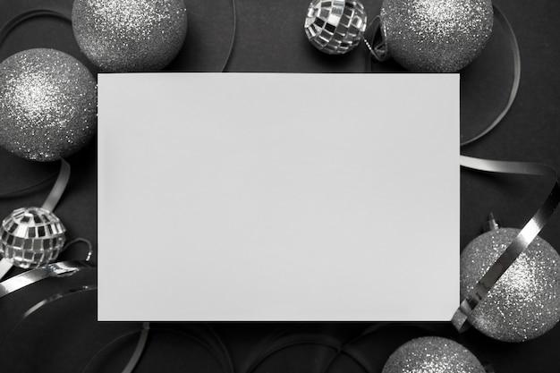 Grey christmas ornaments on black table