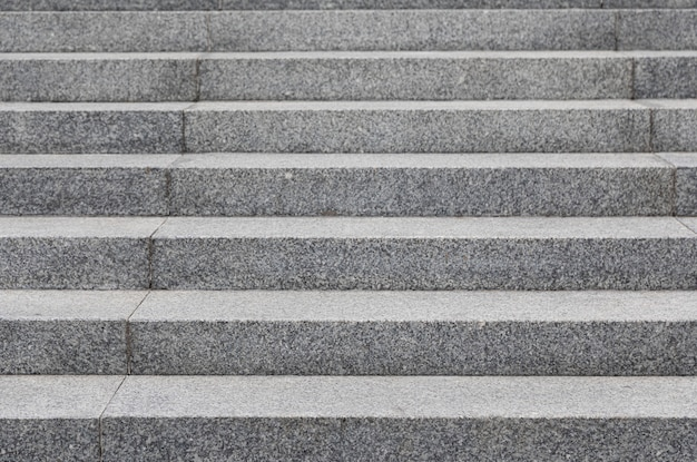 Grey cobblestone stairs in the city,  with grunge texture