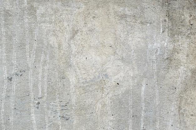 Серая конкретная поврежденная текстура, обои и фон, крупный план