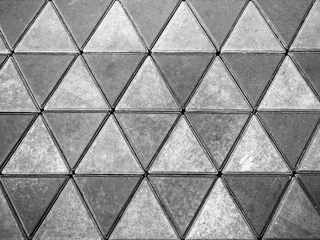 Grey concrete floor, triangle pattern background