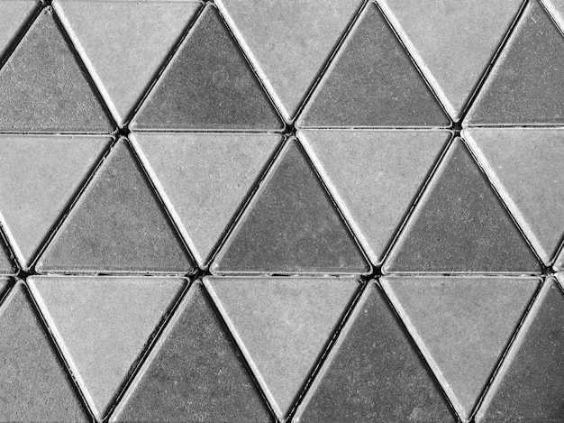 Grey concrete floor, triangle pattern background.