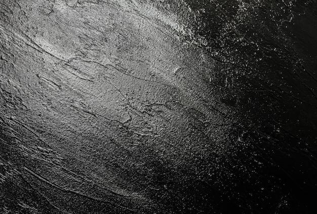 Серая бетонная штукатурка фон. мазки кистью на стене. идея абстрактного искусства. текстура луны. тема вселенной городского пространства.