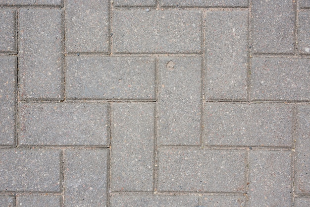 Grey concrete tile on the ground pavement path   texture background